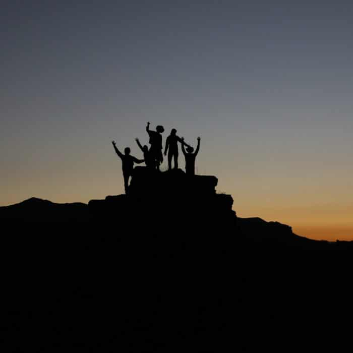 people on the top of a hill friends group