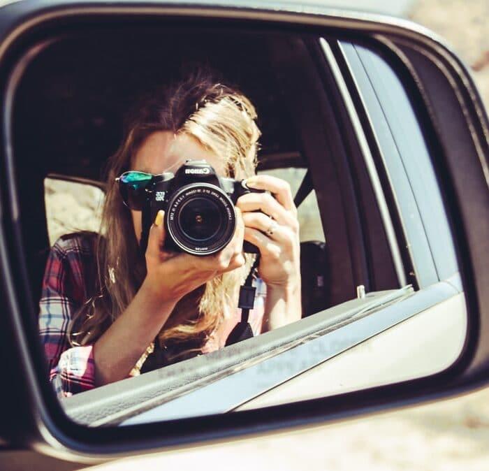 camera in car mirror, woman, influencer