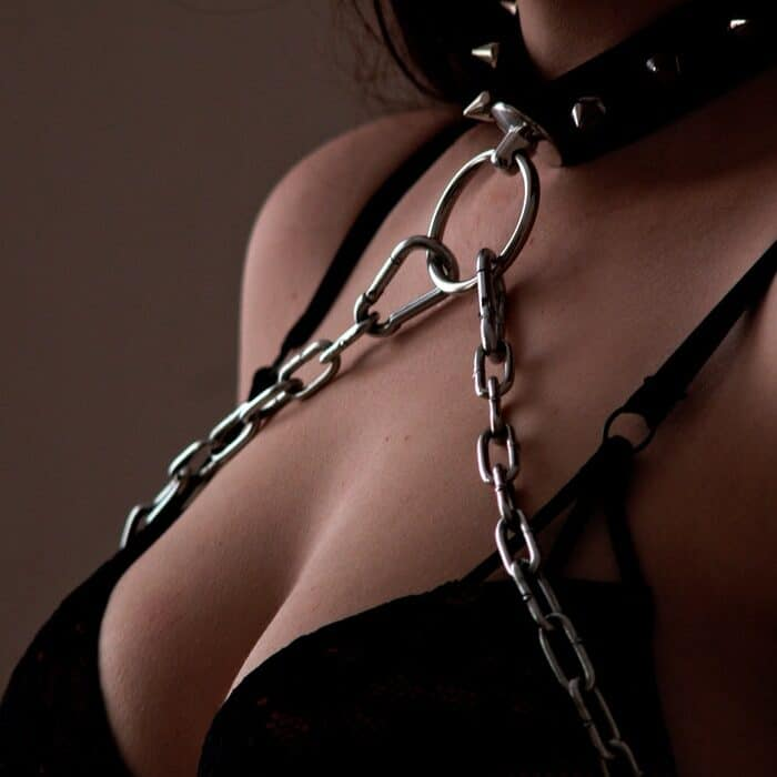 woman in bikini with chains and colar