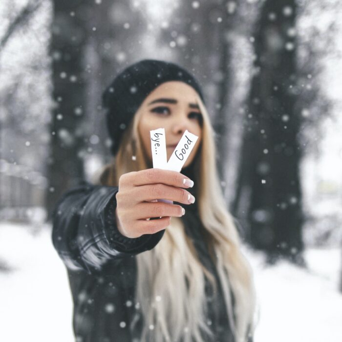 woman holding a goodbye slips of paper snow influencer