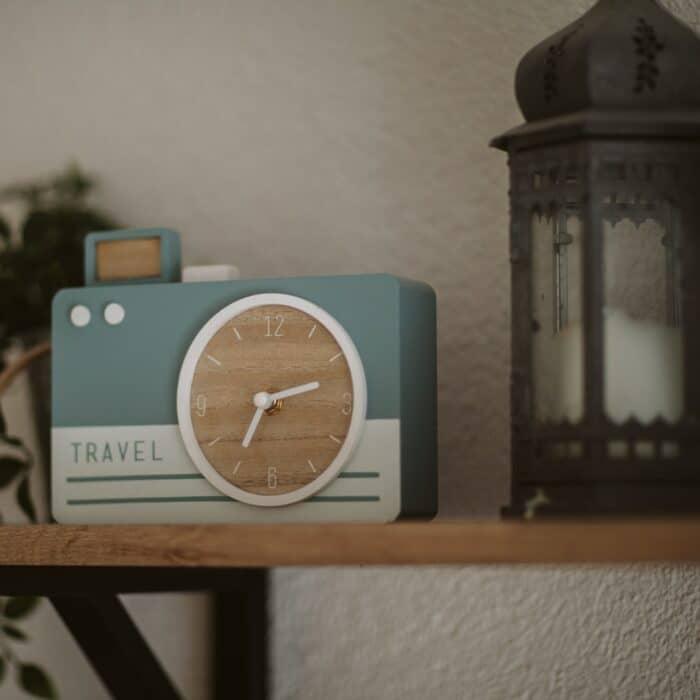 camera clock on a shelf