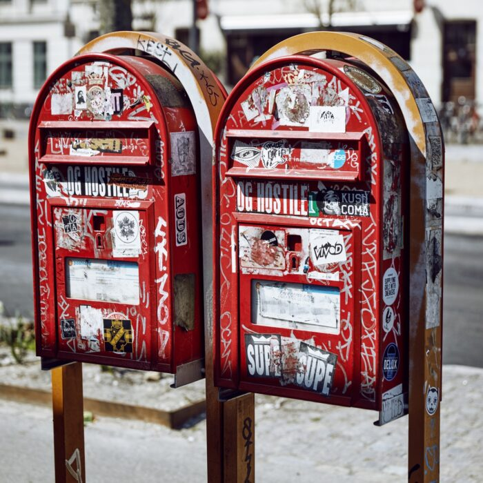 mailboxes covered in stickers