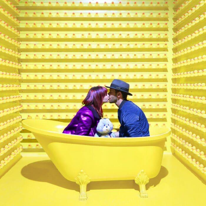 ducks kissing couple in bathtub yellow