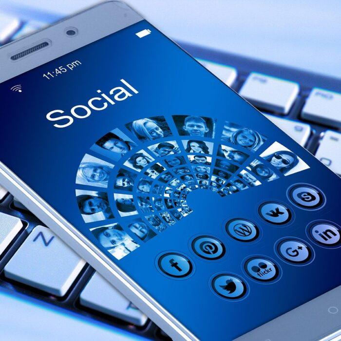 social media on mobile phone blue