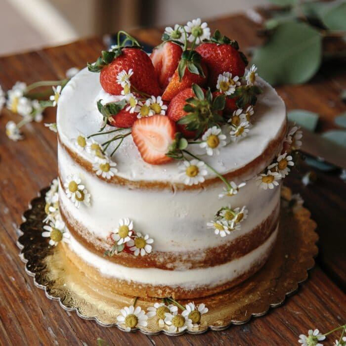 cake with strawberries and flowers