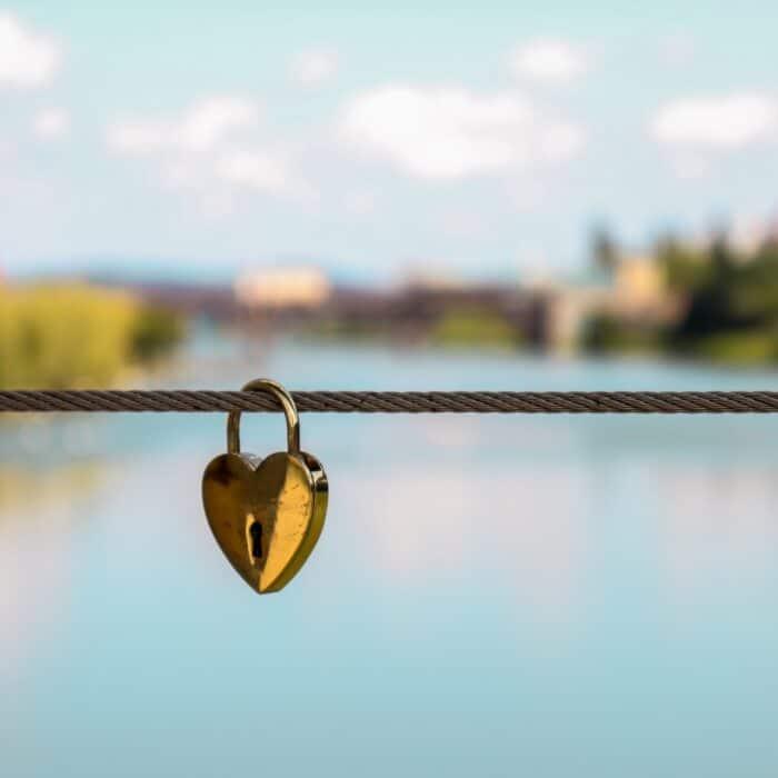 hear lock on a string on a bridge river