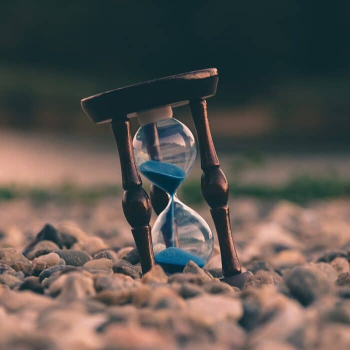 hourglass in gravel time clock