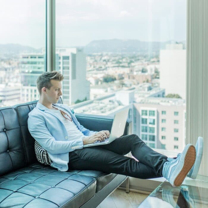 man on laptop sitting in building