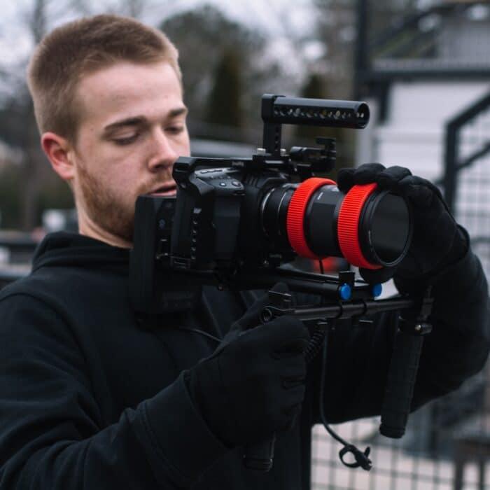 man holding a video camera photographer videographer