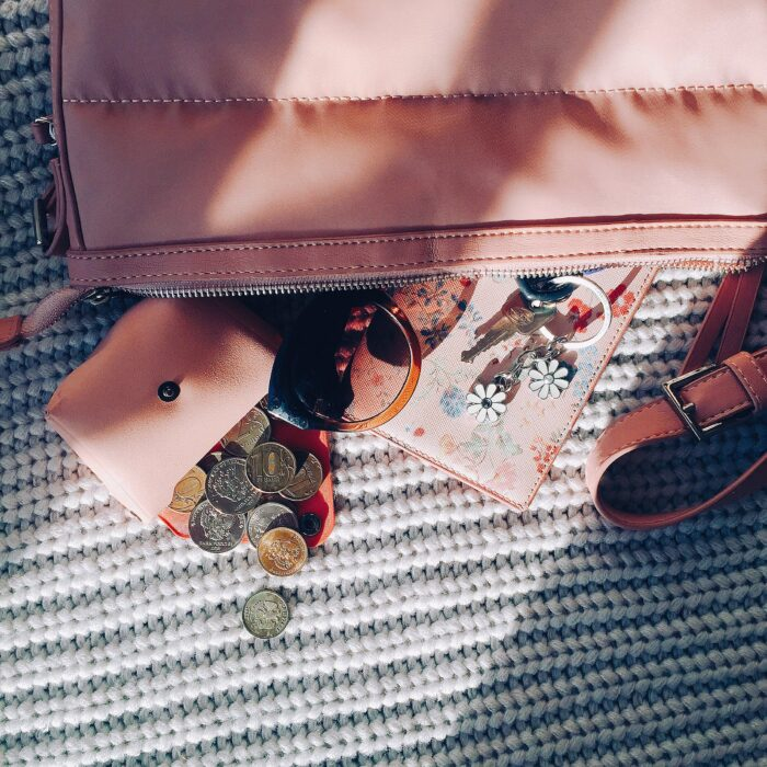 money and keys coming out of a purse