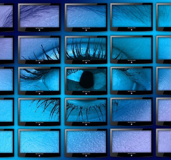 woman eye in monitors with tv