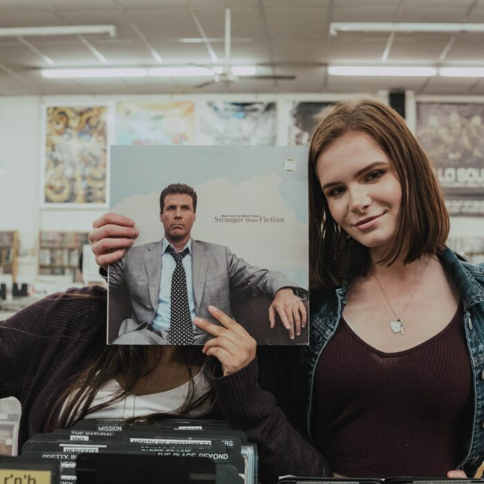 woman holding a record at a record store