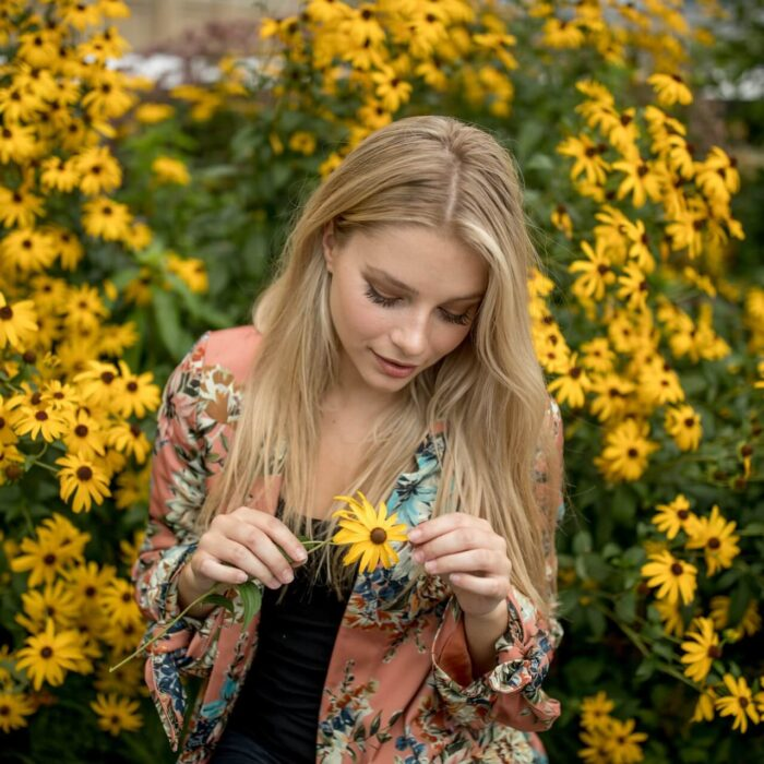 woman holding a flower influencer