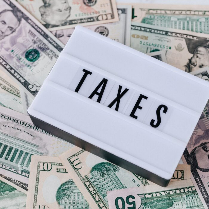 taxes sign sitting on cash