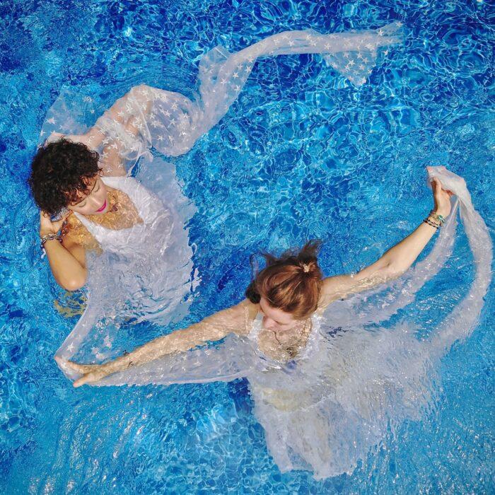 women swimming in a pool