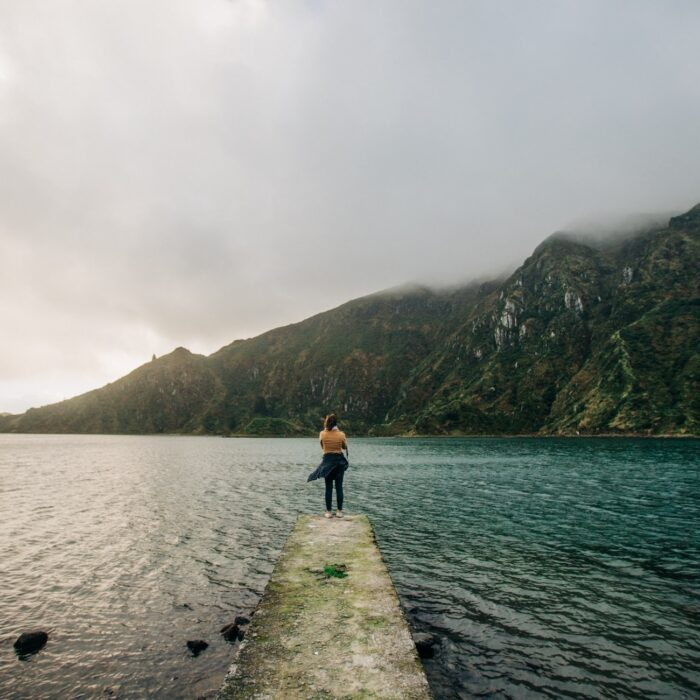 woman standing on a dock landscape influencer