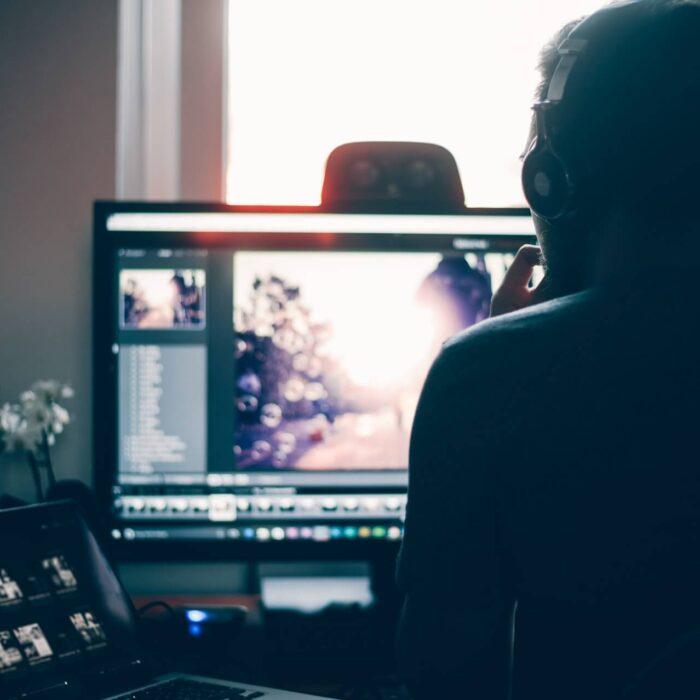 man on youtube looking at desktop editor
