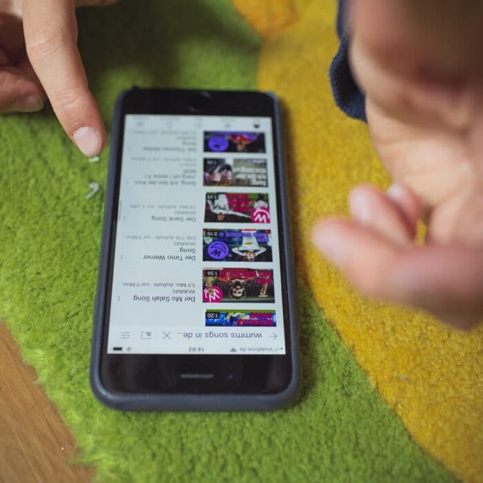 youtube on a mobile phone someone scrolling