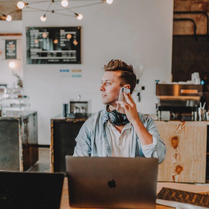 man on phone using computer