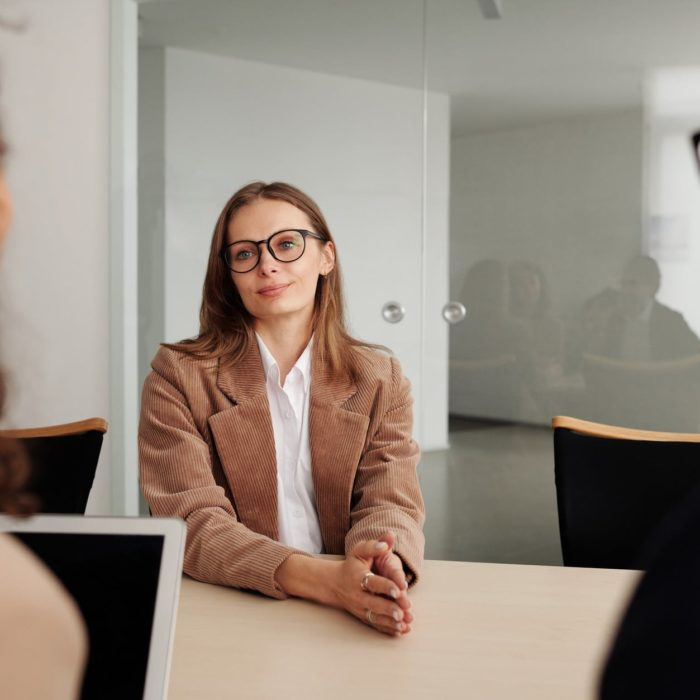 woman interviews two individuals