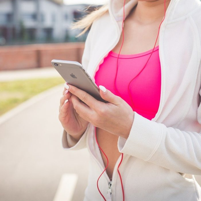 fit woman with iphone