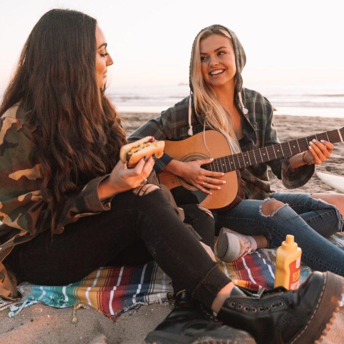 girls singing on beach