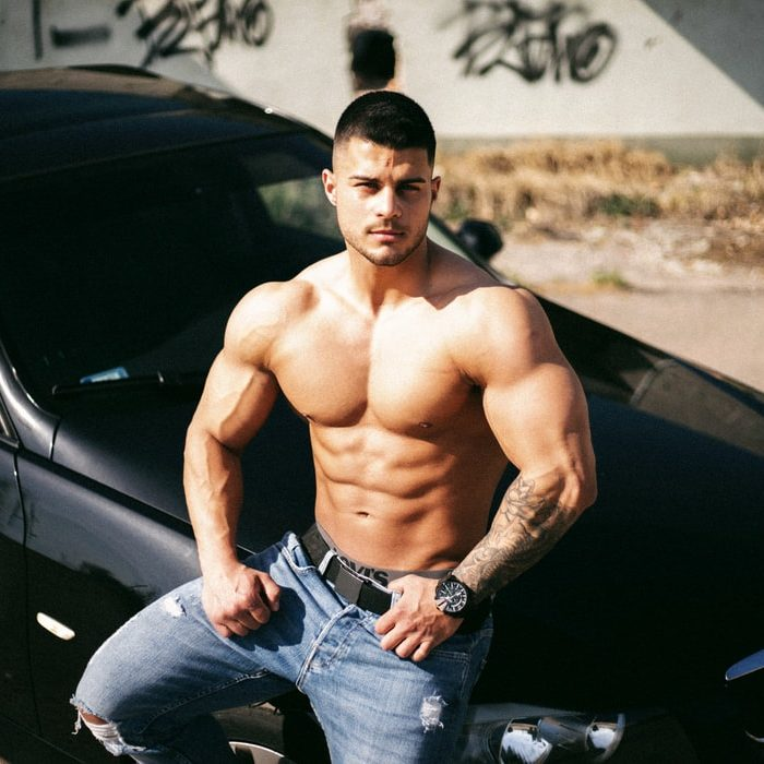 muscle man on a car