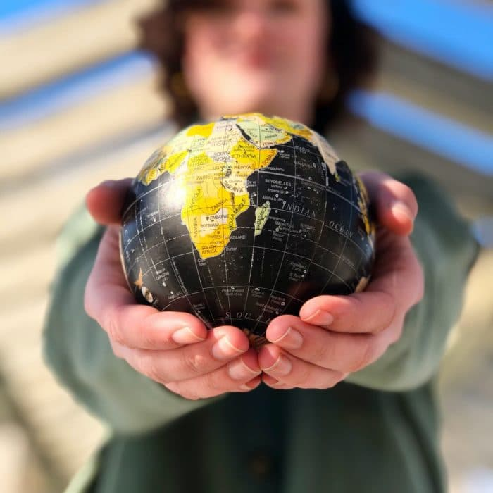 someone holding a globe