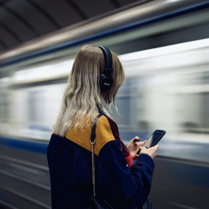 woman headphones train