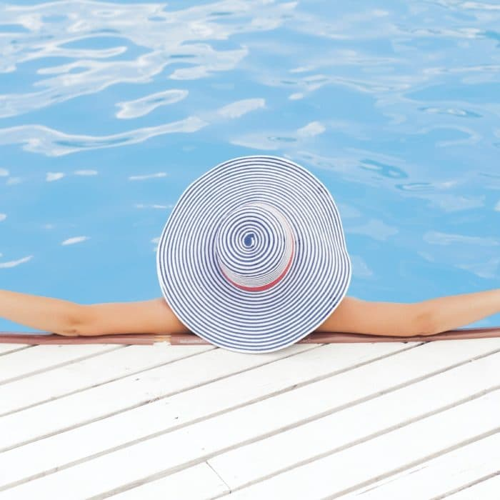 woman in pool with hat