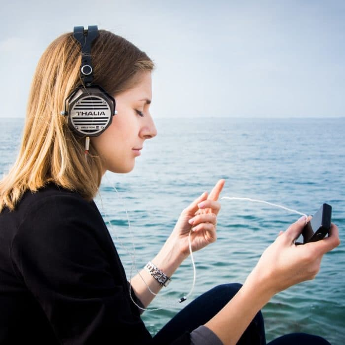 woman listening to music at the lake