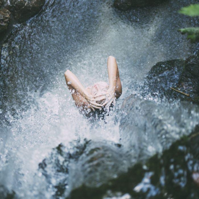 woman in waterfall